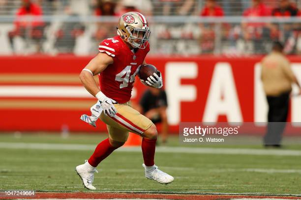 Kyle Juszczyk of the San Francisco 49ers rushes with the ball against the Arizona Cardinals during their NFL game at Levi's Stadium on October 7 2018...