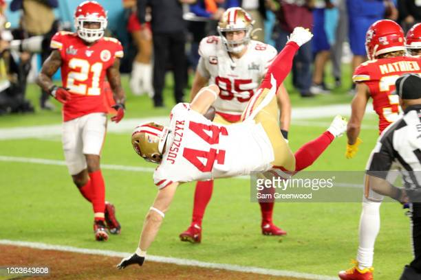 Kyle Juszczyk of the San Francisco 49ers scores a 15yard touchdown in the second quarter of Super Bowl LIV against the Kansas City Chiefs at Hard...
