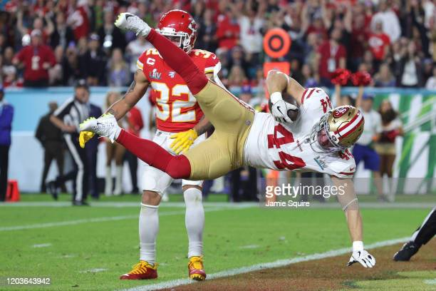 Kyle Juszczyk of the San Francisco 49ers scores on a 15yard touchdown reception in the second quarter of Super Bowl LIV against the Kansas City...