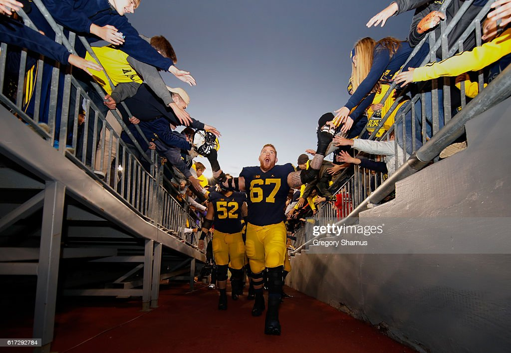 Kyle Kalis #67 of the Michigan Wolverines leaves the field after a 41-8 win over the Illinois Fighting Illini on October 22, 2016 at Michigan Stadium in Ann Arbor, Michigan.