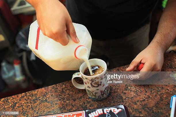 Kyle Kaly adds milk to his cup of coffee at the Undergrounds Coffeehaus on June 7 2011 in Fort Lauderdale Florida Reports indicate that the price of...