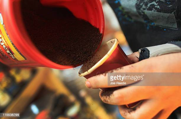 Kyle Kaly measures out ground coffee to brew a new pot at the Undergrounds Coffeehaus on June 7 2011 in Fort Lauderdale Florida Reports indicate that...