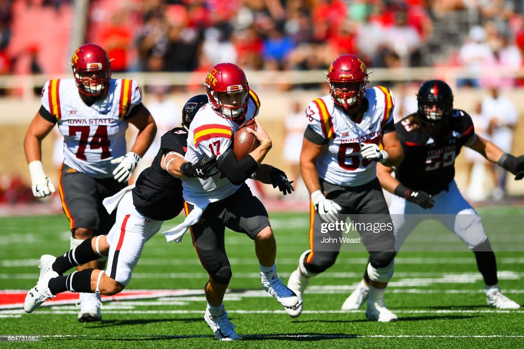 Kyle Kempt #17 of the Iowa State Cyclones gains yardage rushing the ball during the game against the Texas Tech Red Raiders on October 21, 2017 at Jones AT&T Stadium in Lubbock, Texas. Iowa State defeated Texas Tech 31-13.