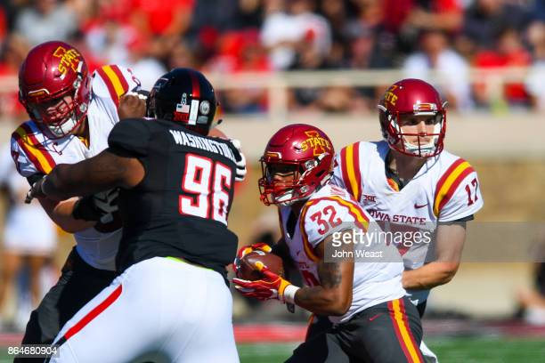 Kyle Kempt of the Iowa State Cyclones hans the ball off to David Montgomery of the Iowa State Cyclones during the game against the Texas Tech Red...
