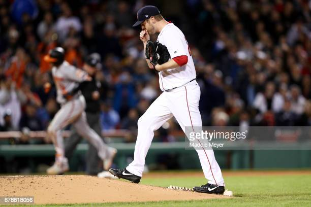 Kyle Kendrick of the Boston Red Sox reacts after Manny Machado of the Baltimore Orioles hit a threerun homer during the fourth inning at Fenway Park...
