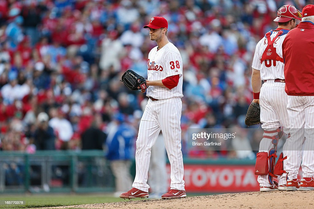 Kyle Kendrick #38 of the Philadelphia Phillies leaves the mound after being pulled in the sixth inning of the Opening Day game against the Kansas City Royals at Citizens Bank Park on April 5, 2013 in Philadelphia, Pennsylvania. The Royals won 13 to 4.