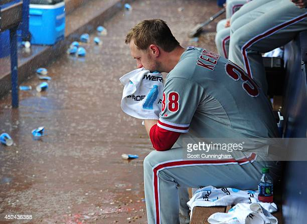 Kyle Kendrick of the Philadelphia Phillies sits in the dugout during a sixth inning rain delay against the Atlanta Braves at Turner Field on July 20...