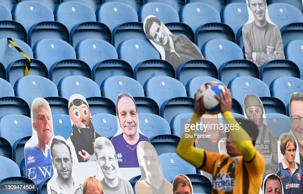 Kyle Knoyle of Cambridge takes a throw in infront of a bank of cardboard fans in the stand including Frank Sidebottom during the Sky Bet League Two...