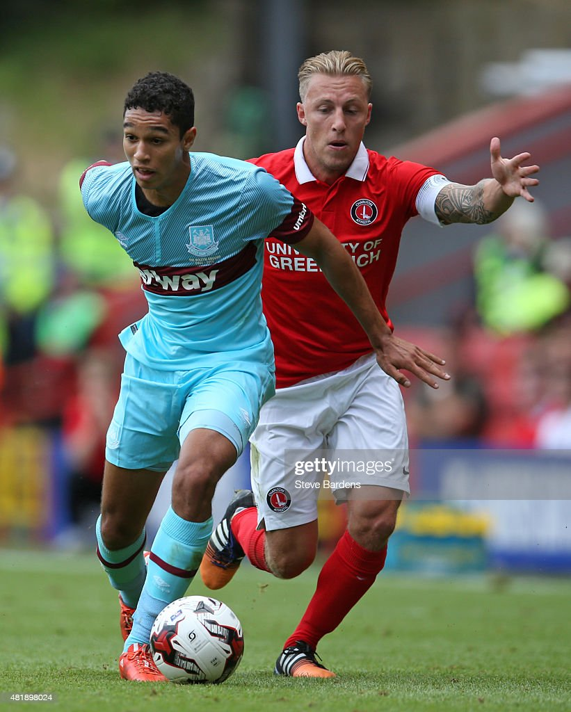 Kyle Knoyle of West Ham United holds off the challenge of Chris Solly of Charlton Athletic during the pre season friendly match between Charlton Athletic and West Ham United at the Valley on July 25, 2015 in London, England.