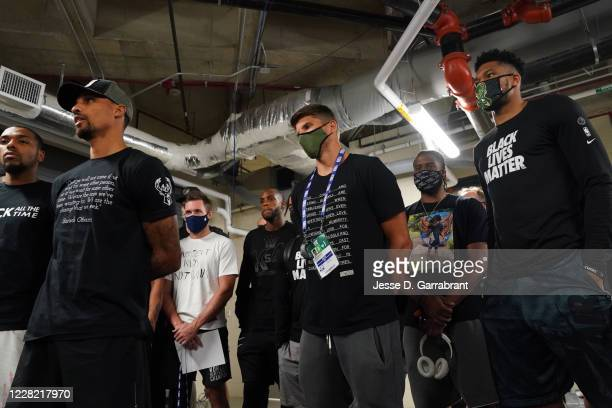 Kyle Korver and Giannis Antetokounmpo of the Milwaukee Bucks during the statement to the media on August 26, 2020 at AdventHealth Arena at ESPN Wide...