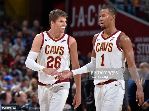 Kyle Korver and Rodney Hood of the Cleveland Cavaliers exchange handshakes during the game against the Detroit Pistons on March 5 2018 at Quicken...