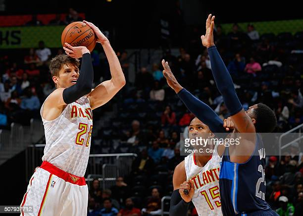 Kyle Korver of the Atlanta Hawks attempts a threepoint basket against Wesley Matthews of the Dallas Mavericks at Philips Arena on February 1 2016 in...