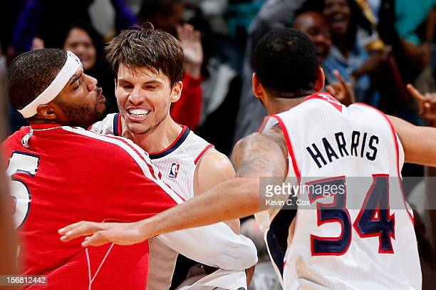 Kyle Korver of the Atlanta Hawks celebrates with Josh Smith and Devin Harris after hitting a goahead threepoint basket against the Washington Wizards...