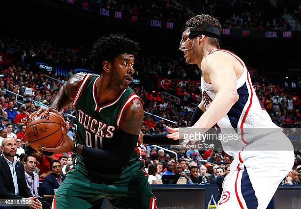 Kyle Korver of the Atlanta Hawks defends against OJ Mayo of the Milwaukee Bucks at Philips Arena on March 30 2015 in Atlanta Georgia NOTE TO USER...