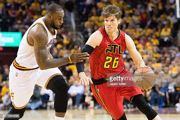 Kyle Korver of the Atlanta Hawks drives around LeBron James of the Cleveland Cavaliers during the second half of the NBA Eastern Conference...