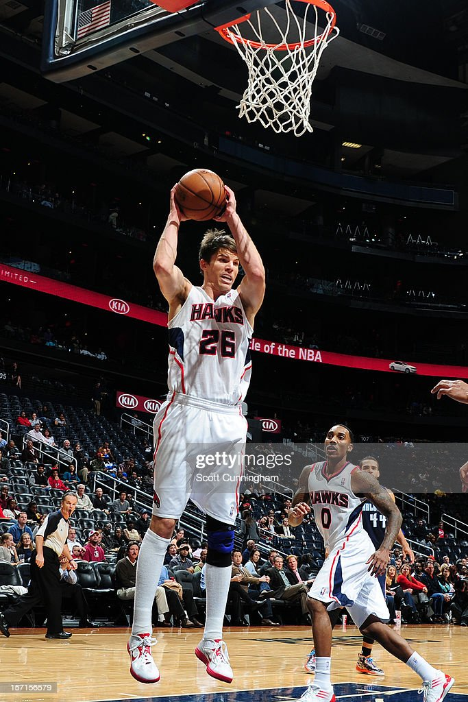 Kyle Korver #26 of the Atlanta Hawks grabs the rebound against the Charlotte Bobcats at Philips Arena on November 28, 2012 in Atlanta, Georgia.