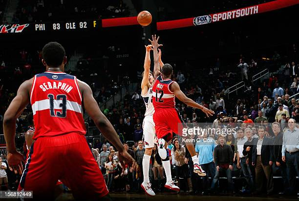 Kyle Korver of the Atlanta Hawks hits a goahead threepoint basket over AJ Price of the Washington Wizards in the final seconds at Philips Arena on...