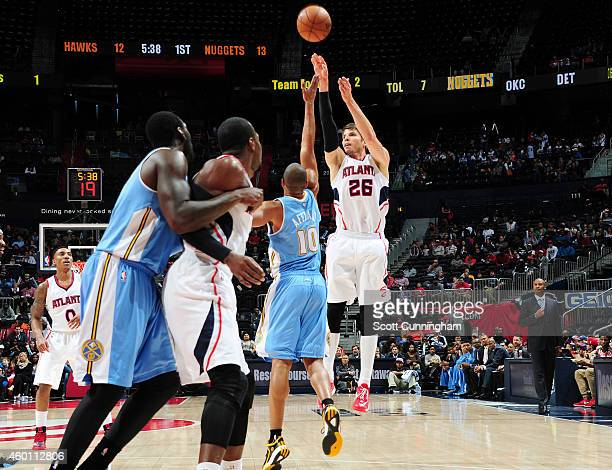 Kyle Korver of the Atlanta Hawks puts up a shot against the Denver Nuggets on December 7 2014 at Philips Arena in Atlanta Georgia NOTE TO USER User...