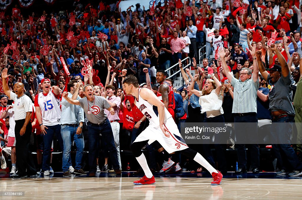 Kyle Korver #26 of the Atlanta Hawks reacts after hitting a three-point basket over Bradley Beal #3 of the Washington Wizards during Game Two of the Eastern Conference Semifinals of the 2015 NBA Playoffs at Philips Arena on May 5, 2015 in Atlanta, Georgia.