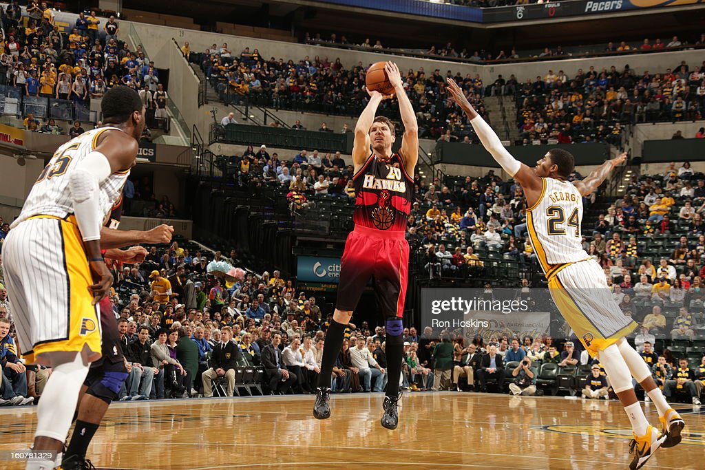 Kyle Korver #26 of the Atlanta Hawks shoots a wide-open shot against Paul George #24 of the Indiana Pacers on February 5, 2013 at Bankers Life Fieldhouse in Indianapolis, Indiana.