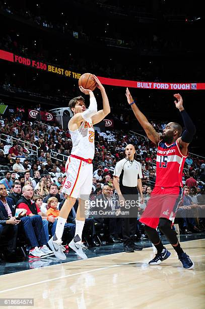 Kyle Korver of the Atlanta Hawks shoots the ball against Marcus Thornton of the Washington Wizards on October 27 2016 at Philips Arena in Atlanta...
