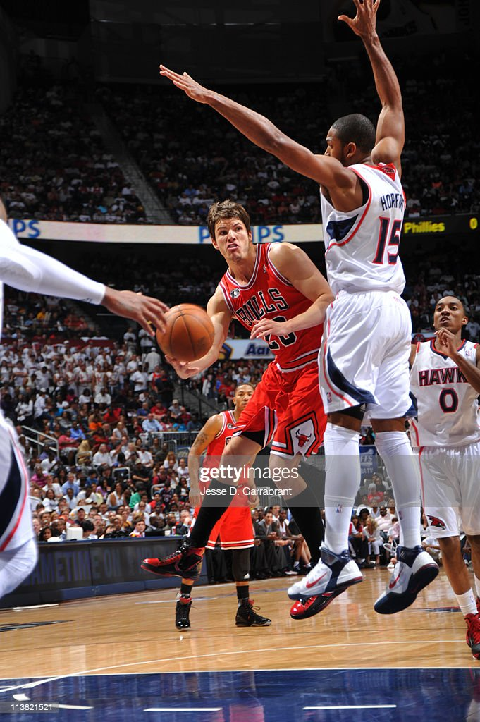 Kyle Korver #26 of the Chicago Bulls passes against Al Horford #15 of the Atlanta Hawks in Game Three of the Eastern Conference Semifinals in the 2011 NBA Playoffs on May 6, 2011 at the Phillips Arena in Atlanta, Georgia.