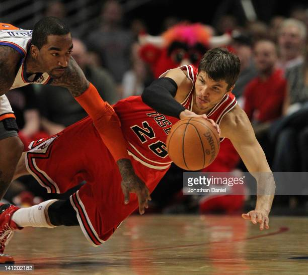 Kyle Korver of the Chicago Bulls saves a loose ball under pressure from Iman Shumpert of the New York Knicks at the United Center on March 12 2012 in...
