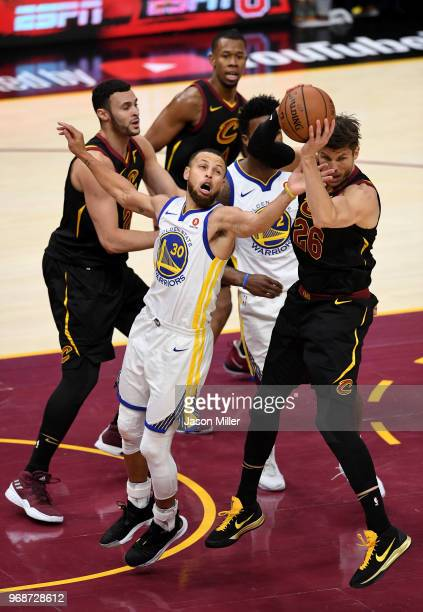 Kyle Korver of the Cleveland Cavaliers and Stephen Curry of the Golden State Warriors battle for a rebound in the fourth quarter during Game Three of...