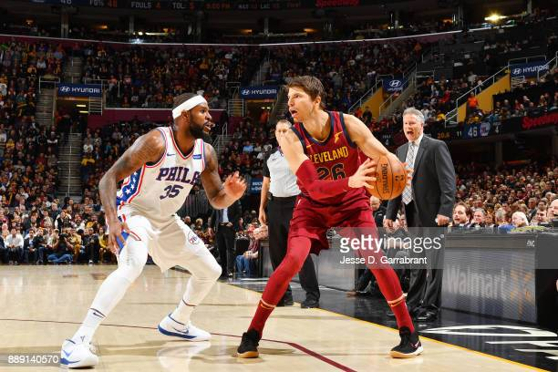 Kyle Korver of the Cleveland Cavaliers handles the ball against Trevor Booker of the Philadelphia 76ers on December 9 2017 at Quicken Loans Arena in...