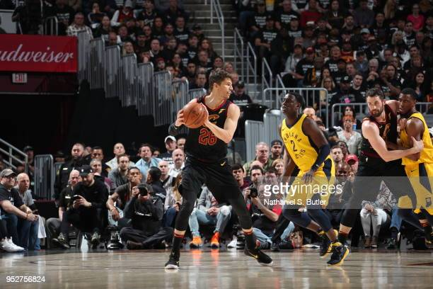Kyle Korver of the Cleveland Cavaliers handles the ball against Darren Collison of the Indiana Pacers in Game Seven of Round One of the 2018 NBA...