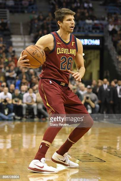 Kyle Korver of the Cleveland Cavaliers handles the ball during a game against the Milwaukee Bucks at the Bradley Center on December 19 2017 in...