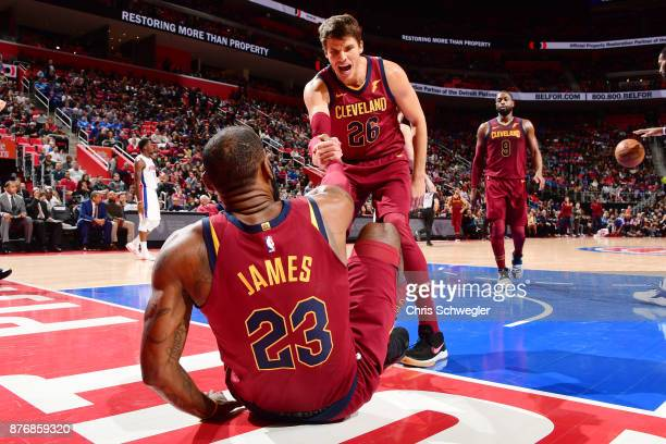 Kyle Korver of the Cleveland Cavaliers helps LeBron James to his feet as they face the Cleveland Cavaliers on November 20 2017 at Little Caesars...