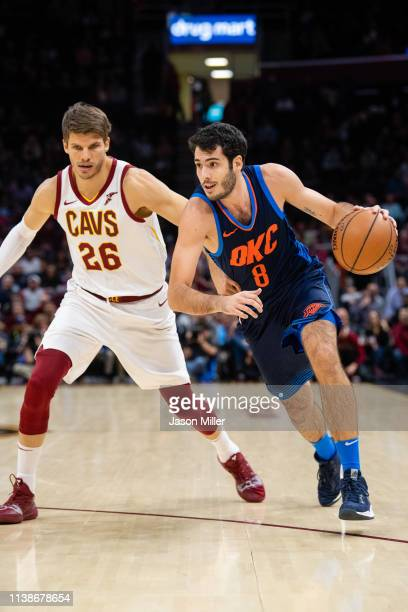 Kyle Korver of the Cleveland Cavaliers puts pressure on Alex Abrines of the Oklahoma City Thunder during the first half at Quicken Loans Arena on...
