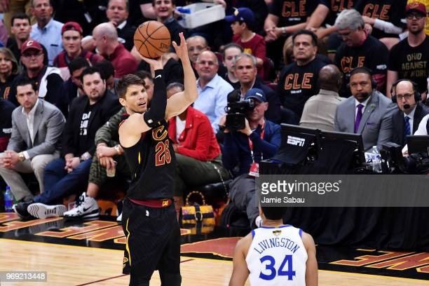 Kyle Korver of the Cleveland Cavaliers shoots against Shaun Livingston of the Golden State Warriors during Game Three of the 2018 NBA Finals at...