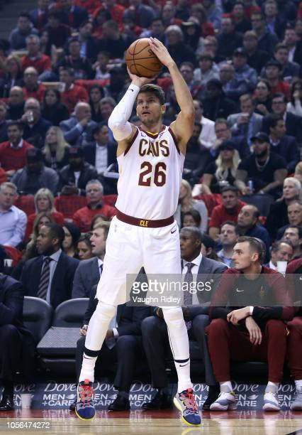 Kyle Korver of the Cleveland Cavaliers shoots the ball in the first half of the NBA season opener against the Toronto Raptors at Scotiabank Arena on...
