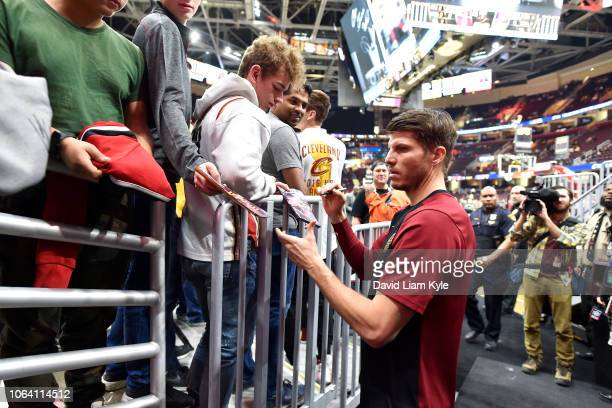 Kyle Korver of the Cleveland Cavaliers signs autograph for fans before the game against the Los Angeles Lakers on November 21 2018 at Quicken Loans...