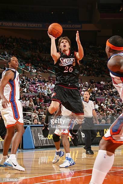 Kyle Korver of the Philadelphia 76ers shoots against the New York Knicks during the preseason game on October 24 2006 at Madison Square Garden in New...