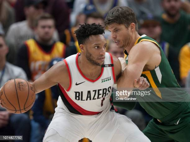 Kyle Korver of the Utah Jazz defends Evan Turner of the Portland Trail Blazers during their game at the Vivint Smart Home Arena on December 25 2018...