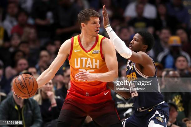 Kyle Korver of the Utah Jazz is guarded by Malik Beasley of the Denver Nuggets in the first quarter at the Pepsi Center on February 28 2019 in Denver...