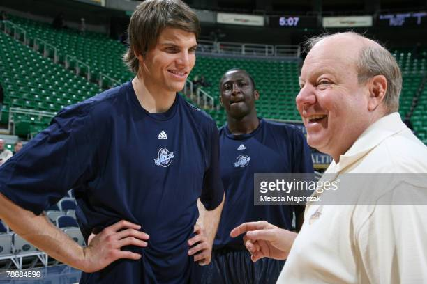 Kyle Korver of the Utah Jazz meets team owner Larry H Miller prior to a game against the Portland Trail Blazers at EnergySolutions Arena on December...