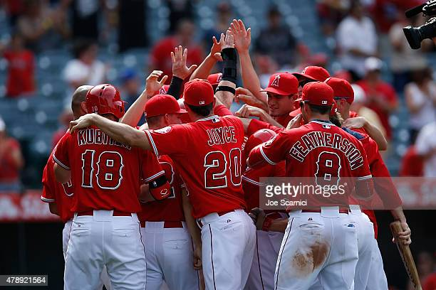 Kyle Kubitza Matt Joyce Taylor Featherston and the rest of the Los Angeles Angels celebrate the winning run by Kole Calhoun on a wild pitch by Tom...