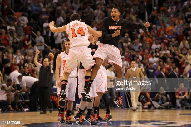 Kyle Kuric and Angel Nunez of the Louisville Cardinals celebrate with teammates after defeating the Florida Gators 7268 during the 2012 NCAA Men's...