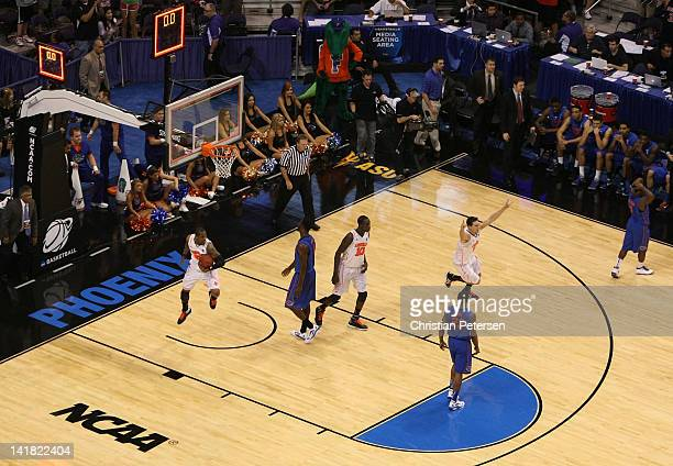 Kyle Kuric of the Louisville Cardinals celebrates with teammates after defeating the Florida Gators 7268 during the 2012 NCAA Men's Basketball West...