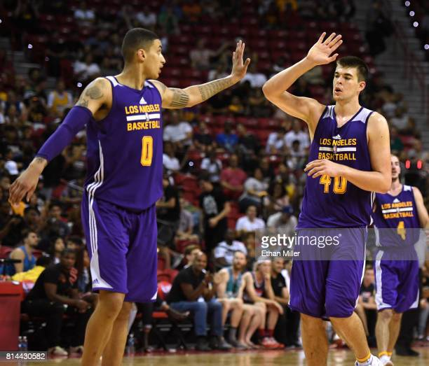Kyle Kuzma and Ivica Zubac of the Los Angeles Lakers highfive after Kuzma hit a 3pointer against the Cleveland Cavaliers during the 2017 Summer...
