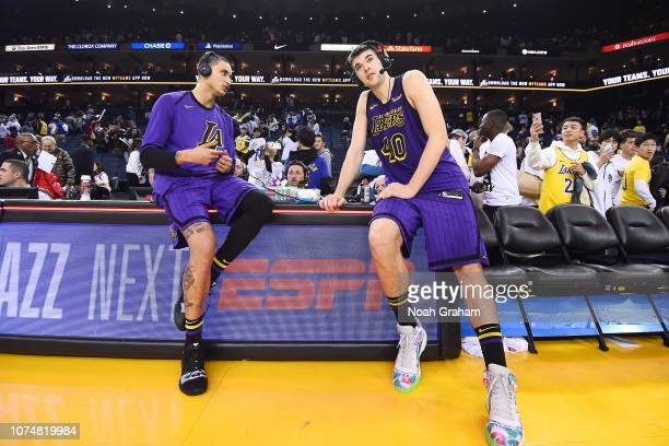 Kyle Kuzma and Ivica Zubac of the Los Angeles Lakers talk to the media after the game against the Golden State Warriors on December 25 2018 at ORACLE...