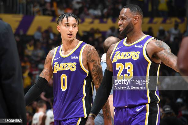 Kyle Kuzma and LeBron James of the Los Angeles Lakers talk to each other against the Miami Heat on November 8 2019 at STAPLES Center in Los Angeles...