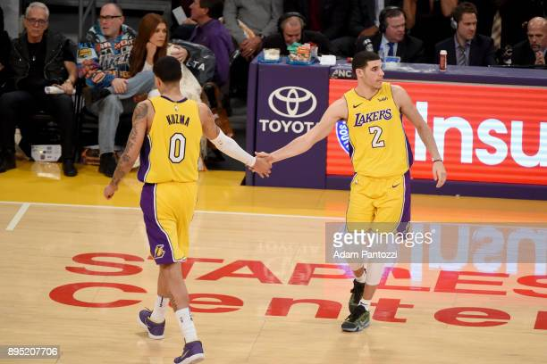 Kyle Kuzma and Lonzo Ball of the Los Angeles Lakers high five during the game against the Golden State Warriors on December 18 2017 at STAPLES Center...