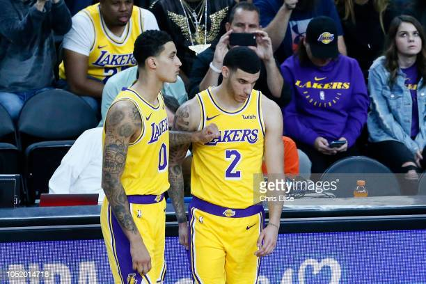 Kyle Kuzma and Lonzo Ball of the Los Angeles Lakers look on during the game against the Golden State Warriors on October 10 2018 at TMobile Arena in...