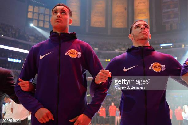 Kyle Kuzma and Lonzo Ball of the Los Angeles Lakers stand on the court for the National Anthem before the game against the Atlanta Hawks on January 7...