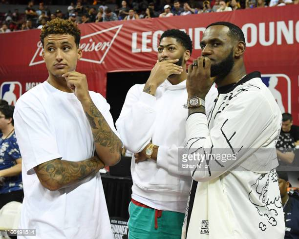 Kyle Kuzma, Anthony Davis and LeBron James of the Los Angeles Lakers talk before a game between the Lakers and the LA Clippers during the 2019 NBA...